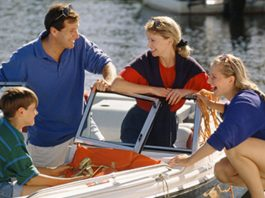 family on a boat, credit union and bank